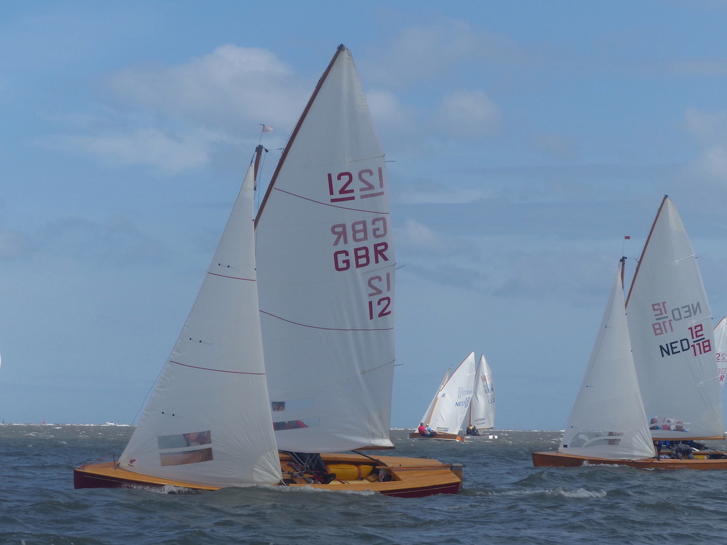 WSC GBR12 with sails catching light behind