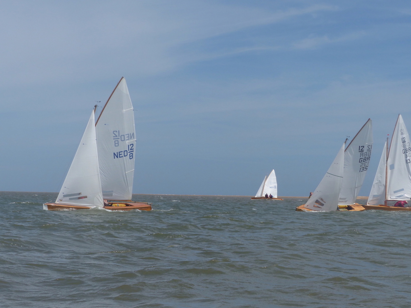 WSC sails catch light in background